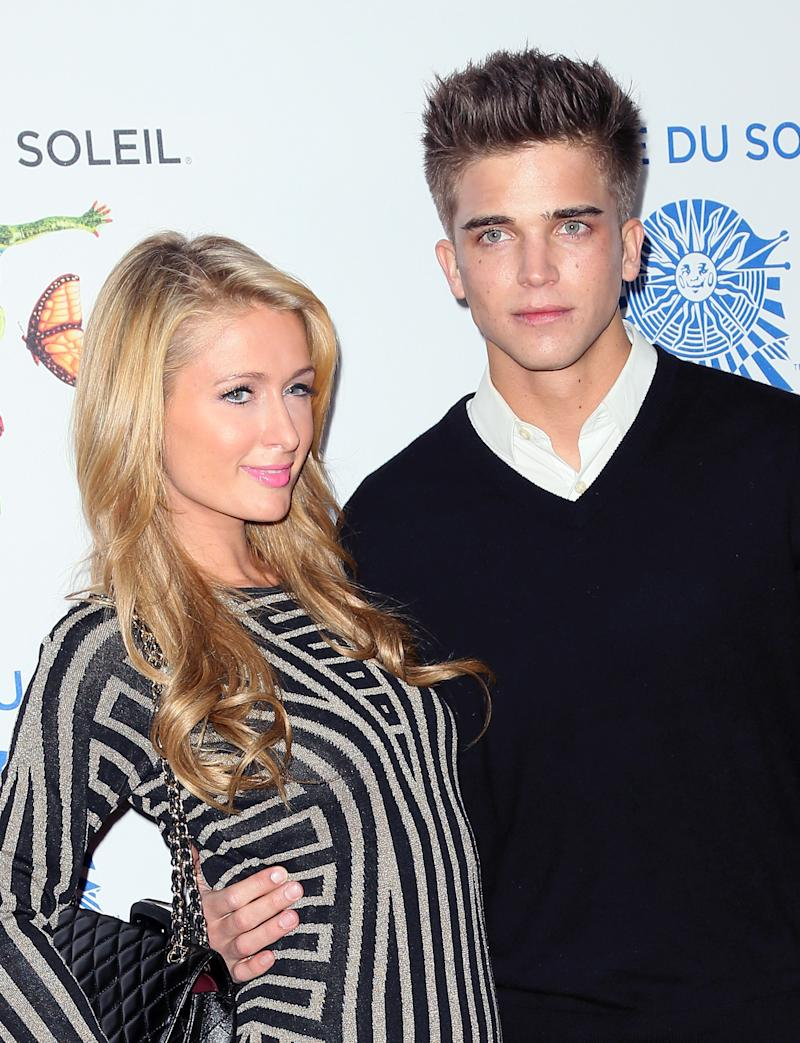 """SANTA MONICA, CA - JANUARY 21: TV personality Paris Hilton (L) and model River Viiperi attend opening night of Cirque du Soleil's """"Totem"""" at the Santa Monica Pier on January 21, 2014 in Santa Monica, California. (Photo by David Livingston/Getty Images)"""