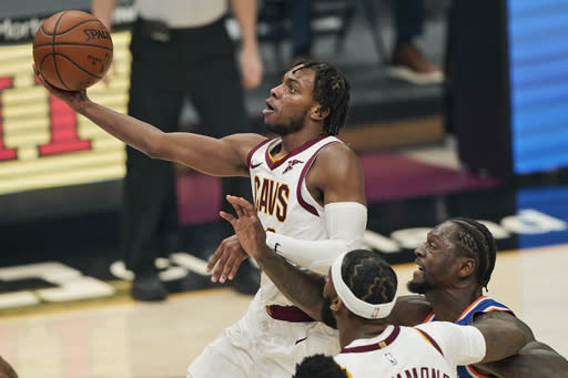 Cleveland Cavaliers' Darius Garland drives to the basket against the New York Knicks in the first half of an NBA basketball game, Tuesday, Dec. 29, 2020, in Cleveland. (AP Photo/Tony Dejak)