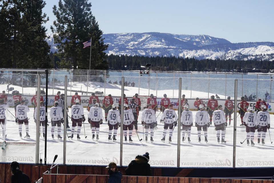 <p>Members of the Colorado Avalanche, foreground and the Vegas Golden Knights, background lineup for the national anthem at the Outdoor Lake Tahoe NHL hockey game in Stateline, Nev., Saturday, Feb. 20, 2021. (AP Photo/Rich Pedroncelli))</p>