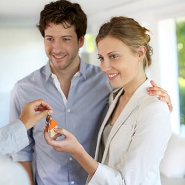 Young-couple-getting-new-house-keys-handed-over_web