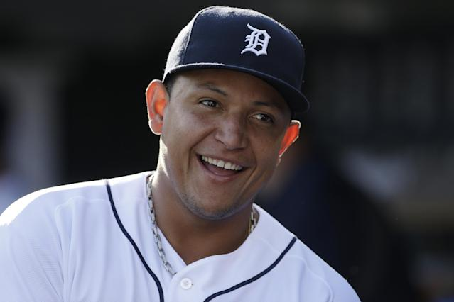 In this July 13, 2013, photo, Detroit Tigers third baseman Miguel Cabrera smiles in the dugout before a baseball game against the Texas Rangers in Detroit. Cabrera has won the American League Most Valuable Player award for the second straight year. Cabrera won by a comfortable margin Thursday, Nov. 14, getting 23 of 30 first-place votes from members of the Baseball Writers' Association of America (AP Photo/Carlos Osorio)