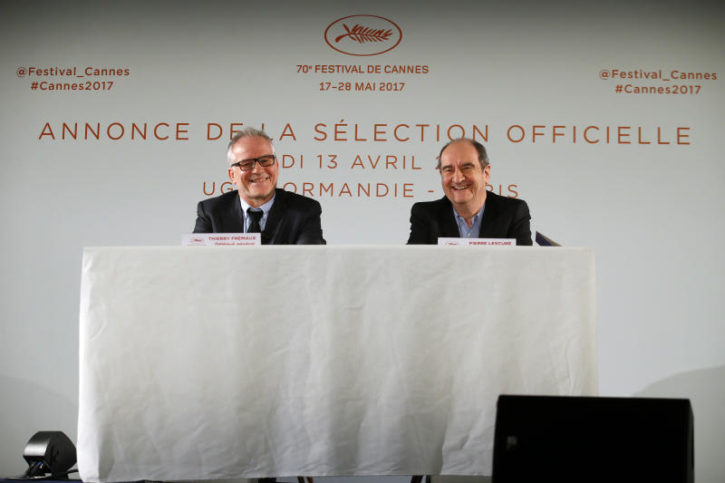 General Delegate of the Cannes Film Festival Thierry Fremaux, left and Cannes Film Festival President Pierre Lescure attend a press conference for the presentation of the 70th Cannes film festival, in Paris, Thursday, April 13, 2017. A Civil War film by Sofia Coppola, a Ukrainian road movie and a film about AIDS activism are among 18 films competing for the top prizes at this year's Cannes Film Festival, which organizers hope can help counter nationalist sentiment. (AP Photo/Francois Mori)