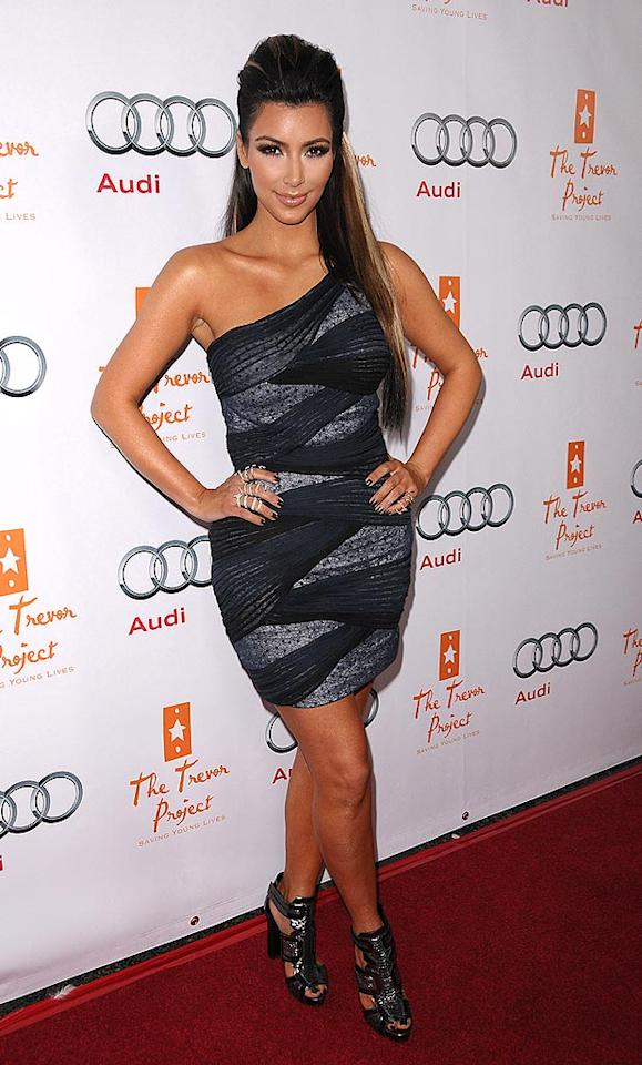 "Kim Kardashian rocked a body-hugging black and grey mini at the 12th annual Cracked Xmas gala in Los Angeles. The reality star explained her questionable streaks on her Twitter. ""Those blonde streaks were extensions that they glued in 4 a shoot! It took hours to get them out and now I have this glue in my hair! Torture!"" Jason LaVeris/<a href=""http://www.filmmagic.com/"" target=""new"">FilmMagic.com</a> - December 6, 2009"