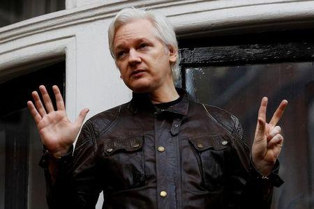FILE PHOTO: WikiLeaks founder Julian Assange is seen on the balcony of the Ecuadorian Embassy in London