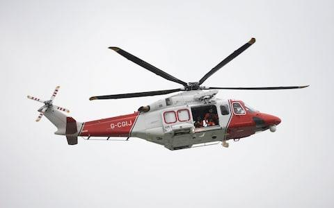 A Coastguard helicopter joined the search for a young child who fell into the River Stour in Sandwich, Kent - Credit: PA