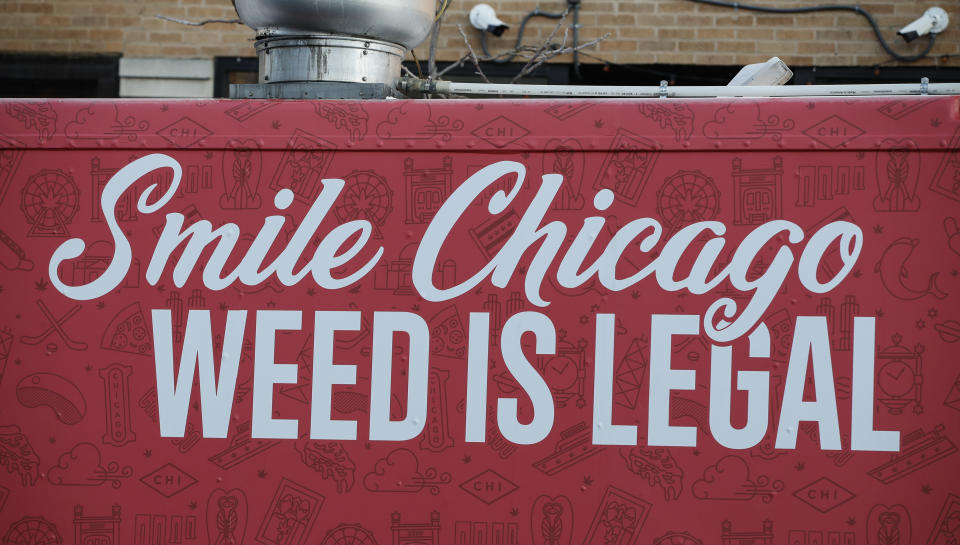 A food truck sits outside the Sunnyside Cannabis Dispensary as customers wait in line to buy marijuana, on January 1, 2020 in Chicago, Illinois. - On the first day of 2020, recreational marijuana  became legal in Illinois, which joins 10 other US states with legal use of recreational marijuana. (Photo by KAMIL KRZACZYNSKI / AFP) (Photo by KAMIL KRZACZYNSKI/AFP via Getty Images)