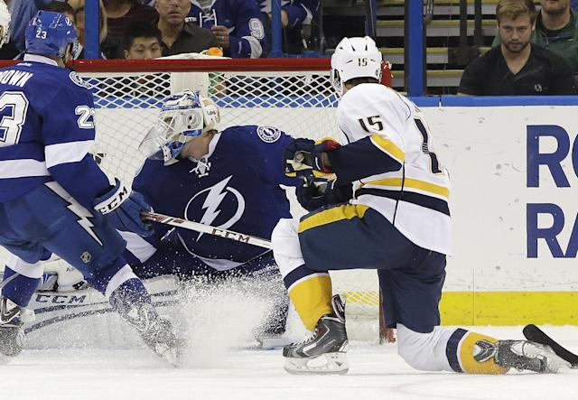 Nashville Predators center Craig Smith (15) fires the puck past Tampa Bay Lightning goalie Anders Lindback (39), of Sweden, for a goal during the second period of an NHL hockey game, Thursday, Dec. 19, 2013, in Tampa, Fla. (AP Photo/Chris O'Meara)
