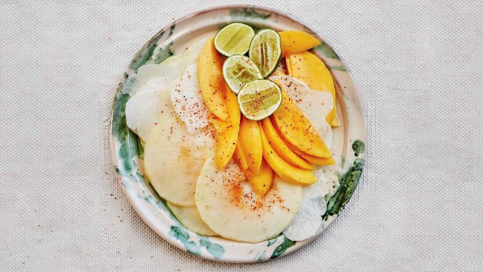 "Don't worry about removing all of the melon seeds in this take on the popular Mexican street snack—they're edible and add a little crunch. <a href=""https://www.bonappetit.com/recipe/honeydew-jicama-and-mango-salad?mbid=synd_yahoo_rss"" rel=""nofollow noopener"" target=""_blank"" data-ylk=""slk:See recipe."" class=""link rapid-noclick-resp"">See recipe.</a>"