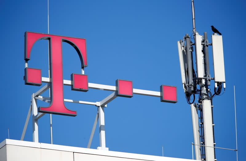 FILE PHOTO: The logo of German telecoms giant Deutsche Telekom and GSM antennas are seen atop the company's headquarters in Bonn