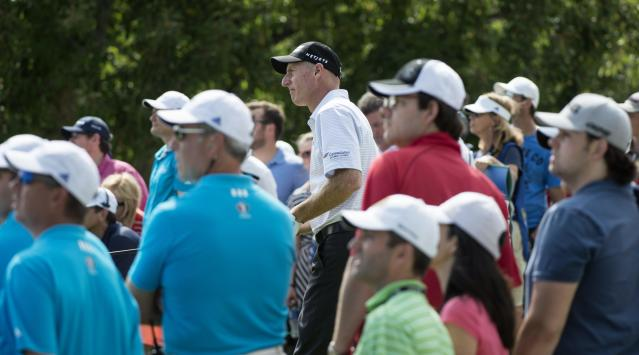 Jim Furyk watches his ball after hitting on the ninth tee during the third round of the Canadian Open golf championship at the Royal Montreal Golf Club in Montreal, Saturday, July 26, 2014. (AP Photo/The Canadian Press, Paul Chiasson)