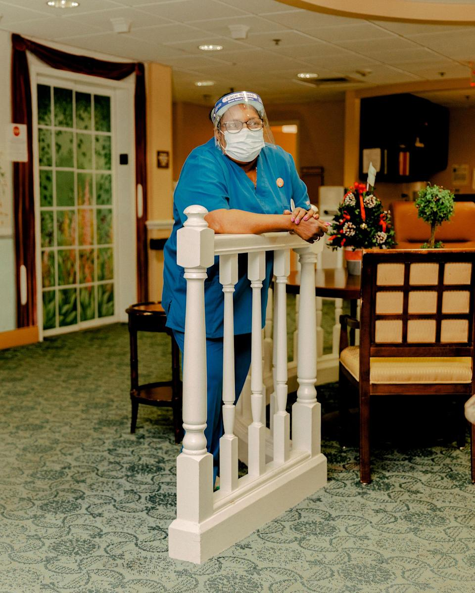 "Lil Parks, a nurse's assistant at Westminster and a Jamaica native, often sings Bob Marley songs to keep residents' spirits up. She got her first shot the same day<span class=""copyright"">Evan Jenkins for TIME</span>"