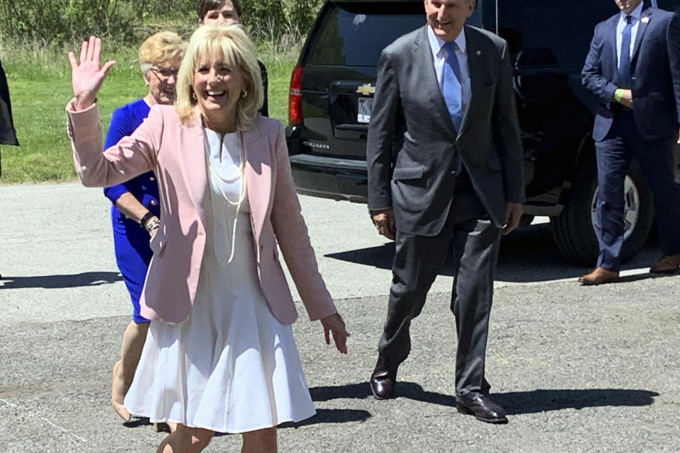 First lady Jill Biden arrives at a vaccination clinic Thursday, May 13, 2021, at a high school in Charleston, W.Va. Behind her are U.S. Sen. Joe Manchin of West Virginia and his wife, Gayle Manchin. (Kenny Kemp/Charleston Gazette-Mail via AP)