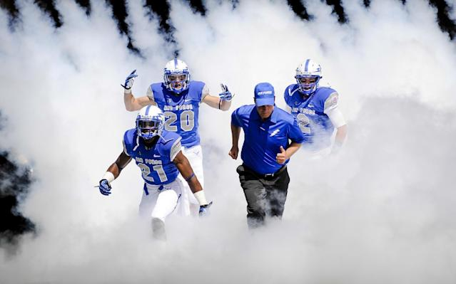 Air Force Academy football players and head coach Troy Calhoun run out onto the field for an NCAA college football game against Colgaite Saturday, Aug., 31, 2013, in Air Force Academy, Colo. (AP Photo/The Colorado Springs Gazette, Michael Ciaglo)