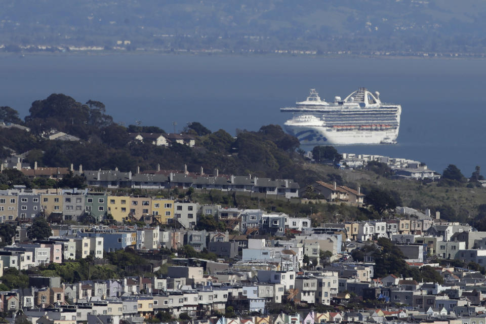 FILE - In this March 31, 2020, file photo, the Grand Princess cruise ship, carrying crew and passengers struck with the coronavirus, is shown in San Francisco. Cruise ships are returning to San Francisco after a 19-month hiatus brought on by the pandemic in what's sure to be a boost to the city's economy, the mayor announced Friday, Oct. 8, 2021. (AP Photo/Jeff Chiu, File)