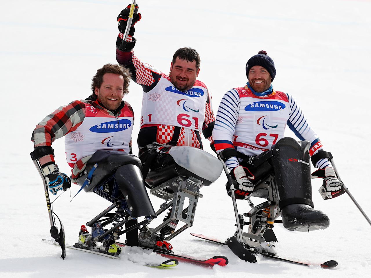 Alpine Skiing - Pyeongchang 2018 Winter Paralympics - Men's Slalom - Sitting - Final - Jeongseon Alpine Centre - Jeongseon, South Korea - March 17, 2018 - Gold medallist Dino Sokolovic (61) of Croatia, silver medallist Tyler Walker (73) of the U.S. and bronze medallist Frederic Francois (67) of France. REUTERS/Paul Hanna