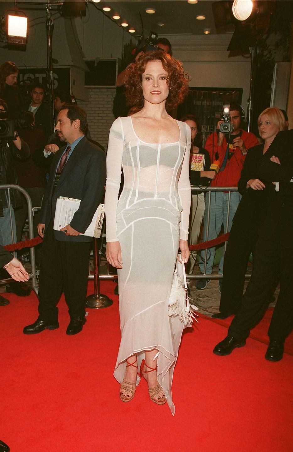 <p>At the premiere of <em>Alien: Resurrection, </em>Sigourney donned this completely sheer white gown and wore black undergarments for ~sexy~ contrast. Also, her bag is made of white feathers, so there's that.</p>