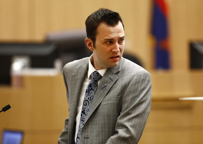 "Steven Alexander, brother of murder victim Travis Alexander, looks back towards Jodi Arias as he reads his ""victim impact statement"" to the jury on Thursday, May 16, 2013 during the penalty phase of the Jodi Arias trial at Maricopa County Superior Court in Phoenix.  Jodi Arias was convicted of first-degree murder in the stabbing and shooting to death of Travis Alexander, 30, in his suburban Phoenix home in June 2008. (AP Photo/The Arizona Republic, Rob Schumacher, Pool)"