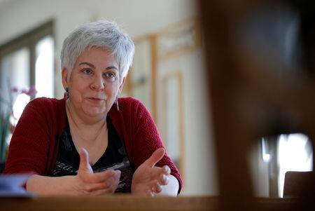 Corinne Francois, opponent to the project of an underground nuclear waste disposal of the French National Radioactive Waste Management Agency ANDRA in the village of Bure called CIGEO, talks to Reuters journalists during an interview at her home in Bar-le-Duc, France, April 6, 2018. Picture taken April 6, 2018. REUTERS/Vincent Kessler