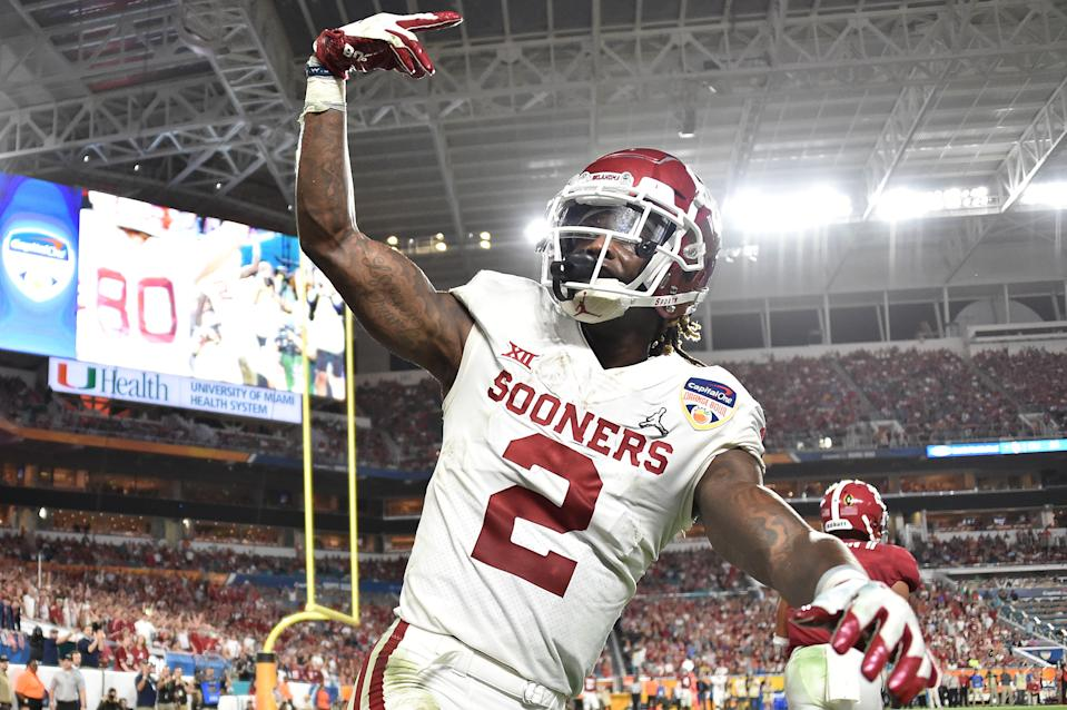 Dec 29, 2018; Miami Gardens, FL, USA; Oklahoma Sooners wide receiver CeeDee Lamb (2) celebrates after catching a touchdown pass in front of Alabama Crimson Tide defensive back Patrick Surtain II (not pictured) during the fourth quarter of the 2018 Orange Bowl college football playoff semifinal game at Hard Rock Stadium. Mandatory Credit: Steve Mitchell-USA TODAY Sports