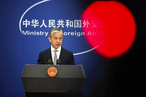 China's Foreign Ministry spokesman Wang Wenbin gives a stern response when asked about London's BN(O) plans. Photo: EPA-EFE