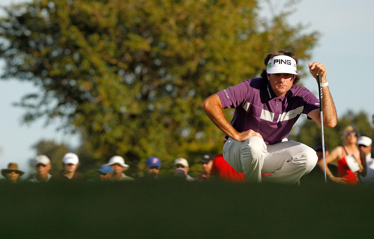 MIAMI, FL - MARCH 10:  Bubba Watson lines up a putt on the 16th hole during the third round of the World Golf Championship's Cadillac Championship at Doral Golf Resort And Spa on March 10, 2012 in Miami, Florida.  (Photo by Mike Ehrmann/Getty Images)