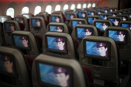 Seats and screens are seen in the economy class cabin of Qatar Airways new Boeing 787 Dreamliner are seen after it arrived on it's inaugural flight to Heathrow Airport, west London