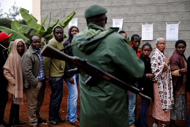 <p>Kenyans queue to cast their vote outside a polling station during the presidential election in Gatundu, Kenya, Aug. 8, 2017. (Photo: Baz Ratner/Reuters) </p>