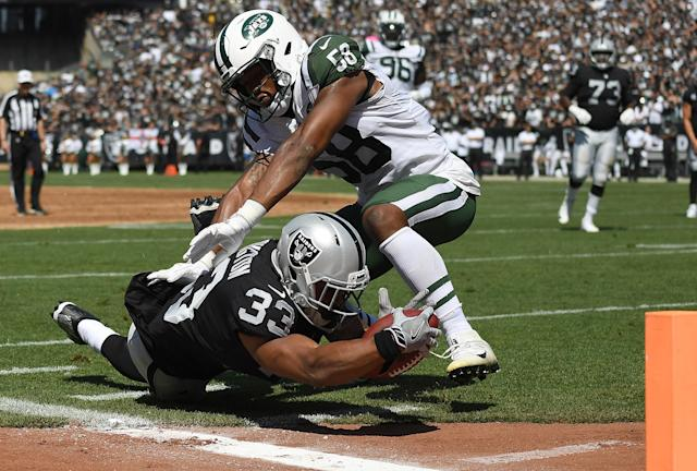 <p>DeAndre Washington #33 of the Oakland Raiders gets tackled at the one yard line by Darron Lee #58 of the New York Jets during the first quarter of their NFL football game at Oakland-Alameda County Coliseum on September 17, 2017 in Oakland, California. (Photo by Thearon W. Henderson/Getty Images) </p>
