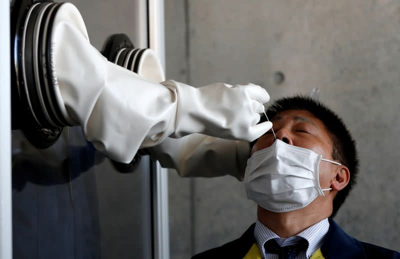 Japan's tripling of coronavirus tests unlikely to improve fight, experts say