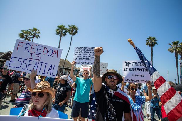 Protest To Reopen California Businesses, Beaches, And Parks Held In Huntington Beach