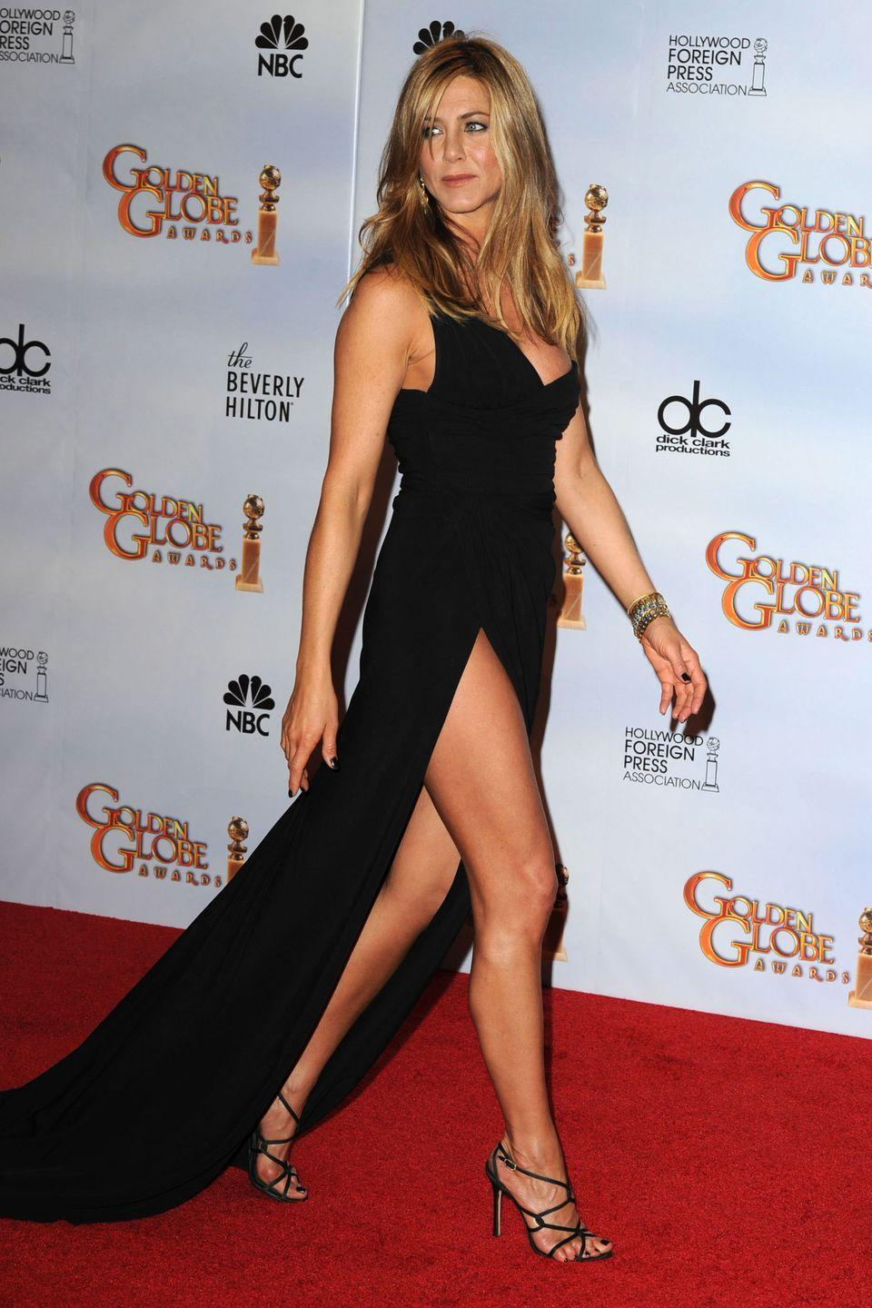 <p>It was all about the legs for Aniston in this simple Valentino gown in 2010.</p>