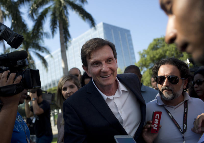 Rio de Janeiro's Mayor Marcelo Crivella talks with the media in Rio de Janeiro, Brazil, Monday, June 19, 2017. Members of Rio de Janeiro's samba schools protested Saturday against the mayor's proposal to slash city funds for next year's Carnival. Crivella plans to reduce the city hall's support from $640,000 (2 million reals) to $320,000 (1 million reals) for each school, and says the difference will be spent on resources for children's day care centers. (AP Photo/Silvia Izquierdo)