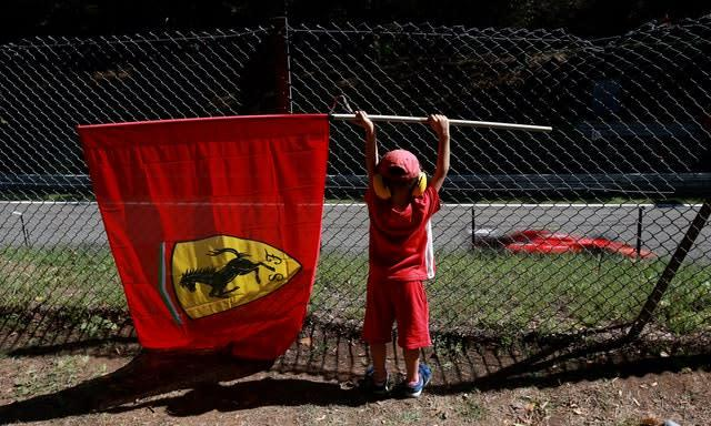 A young Ferrari fan watches the action during the 2015 Italian Grand Prix at Monza. The Italian team were unable to claim victory on home soil as eventual world champion Lewis Hamilton, racing for Mercedes, took the chequered flag ahead of Ferrari's German driver Sebastian Vettel (David Davies/PA)