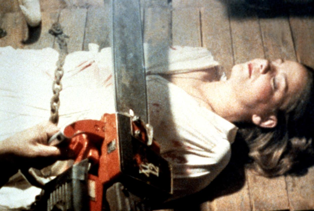 Ash (Campbell) wields his trusty chainsaw for the first time in 'The Evil Dead' (Photo: Courtesy Everett Collection)