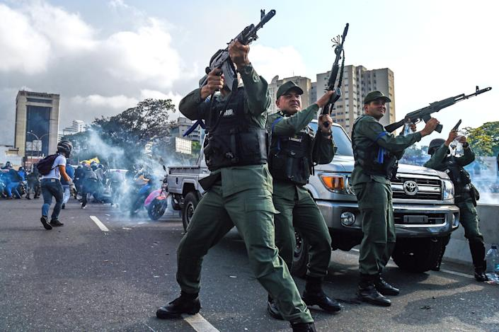 Members of the Bolivarian National Guard who joined Venezuelan opposition leader and self-proclaimed acting president Juan Guaido fire into the air to repel forces loyal to President Nicolas Maduro who arrived to disperse a demonstration near La Carlota military base in Caracas on April 30, 2019. (Photo: Federico Parra/AFP/Getty Images)
