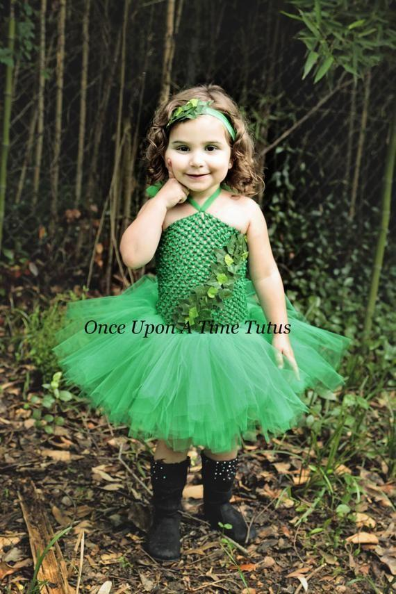 """<p><strong>OnceUponATimeTuTus</strong></p><p>etsy.com</p><p><strong>$78.98</strong></p><p><a href=""""https://go.redirectingat.com?id=74968X1596630&url=https%3A%2F%2Fwww.etsy.com%2Flisting%2F192269377%2Fcreeping-ivy-tutu-dress-girls-size&sref=https%3A%2F%2Fwww.countryliving.com%2Fdiy-crafts%2Fg29402429%2Fdiy-poison-ivy-costume%2F"""" rel=""""nofollow noopener"""" target=""""_blank"""" data-ylk=""""slk:Shop Now"""" class=""""link rapid-noclick-resp"""">Shop Now</a></p><p>Your little one will have a blast twirling in this tutu, which has a comfortable, stretchy top with an ivy vine crawling across it. </p>"""