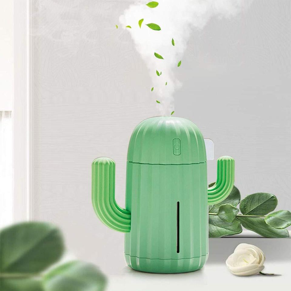 """<h3><a href=""""https://amzn.to/31FYbMA"""" rel=""""nofollow noopener"""" target=""""_blank"""" data-ylk=""""slk:Portable Cactus Air Humidifier With Night Light"""" class=""""link rapid-noclick-resp"""">Portable Cactus Air Humidifier With Night Light </a></h3><br><strong>The Plant-Mom Humidifier</strong><br><br>This teeny-tiny cactus humidifier isn't just cute Instagram bait; it's USB rechargeable and can be programmed to time-release steam for round-the-clock comfort. <br><br><strong>YINGJEE</strong> Mini Portable Cactus Humidifier with Night Light, $, available at <a href=""""https://amzn.to/2MOIH4F"""" rel=""""nofollow noopener"""" target=""""_blank"""" data-ylk=""""slk:Amazon"""" class=""""link rapid-noclick-resp"""">Amazon</a>"""