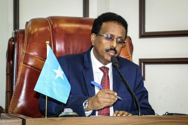 In a brief speech before parliament Somalia's president abandoned a policy extending his term in office by two years
