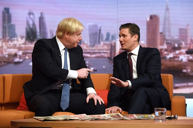 Foreign Secretary Boris Johnson (left) and Shadow Brexit Secretary Sir Keir Starmer during filming for the BBC One current affairs programme The Andrew Marr Show at New Broadcasting House in London. (Photo by Victoria Jones/PA Images via Getty Images)