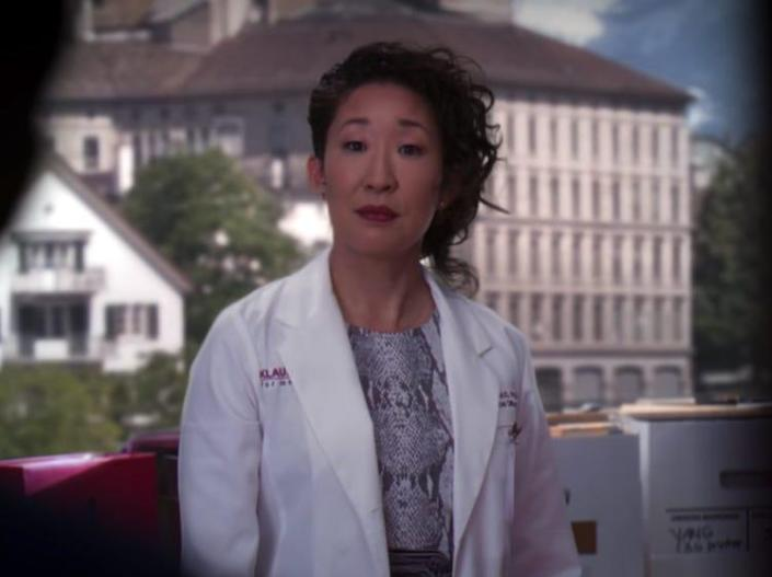 Sandra Oh as Cristina Yang on Greys Anatomy in Switzerland office wearing a dress and white coat