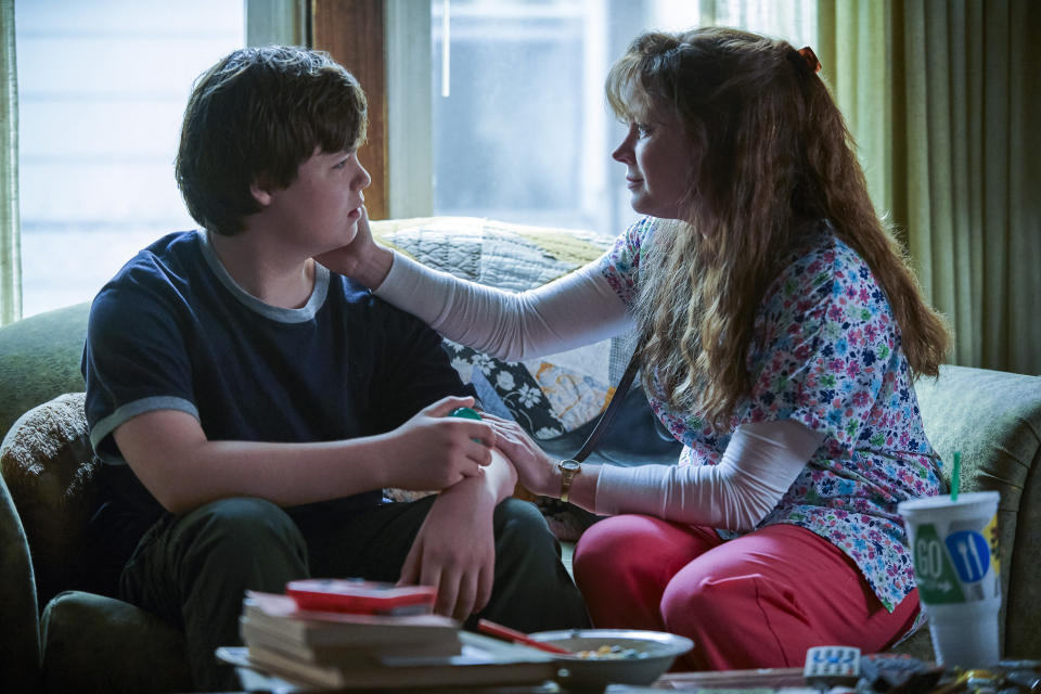 "This image released by Netflix shows Owen Asztalos, left, and Amy Adams in a scene from ""Hillbilly Elegy."" (Lacey Terrell/Netflix via AP)"