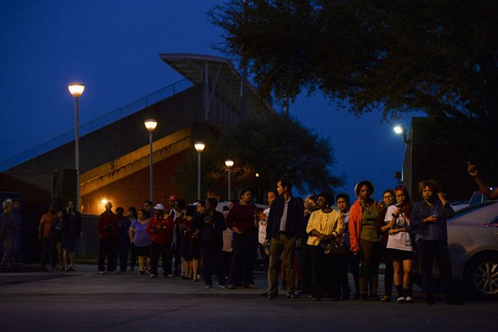 Voters wait in line to cast their ballot in the Democratic primary at a Houston polling place on Super Tuesday. (Photo: Callaghan O'Hare / Reuters)