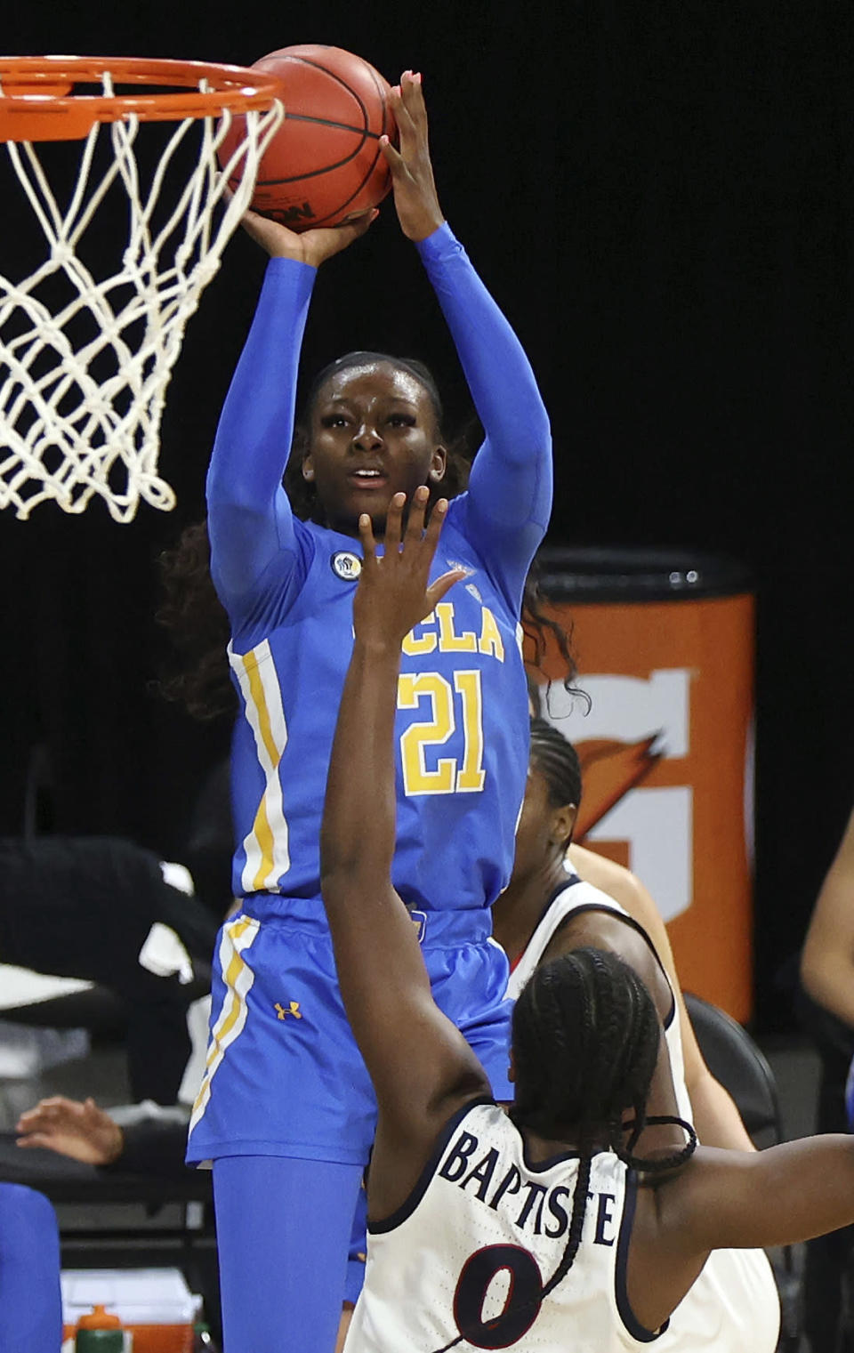 UCLA forward Michaela Onyenwere (21) shoots as Arizona forward Trinity Baptiste (0) defends during the second half of an NCAA college basketball game in the semifinals of the Pac-12 women's tournament Friday, March 5, 2021, in Las Vegas. (AP Photo/Isaac Brekken)