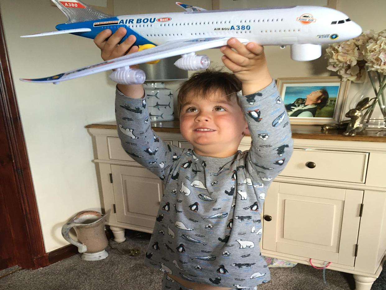 George loves playing with his collection of more than 100 toy planes (Loganair/PA)
