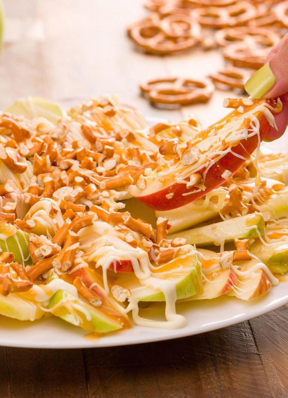 """<p>Who knew apples made such a sweet base for toppings? Your guests will hug you.</p><p>Get the recipe from <a href=""""https://www.delish.com/cooking/recipe-ideas/recipes/a43818/apple-nachos-recipe/"""" rel=""""nofollow noopener"""" target=""""_blank"""" data-ylk=""""slk:Delish"""" class=""""link rapid-noclick-resp"""">Delish</a>.</p>"""