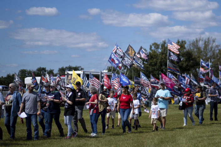 Supporters file into the Georgia National Fairgrounds in Perry, Ga., to attend former president Donald Trump's Save America rally Saturday, Sept. 25, 2021. (AP Photo/Ben Gray)