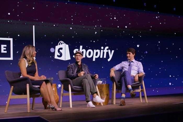 Shopify's CEO speaking on a stage alongside Canada's prime minister.