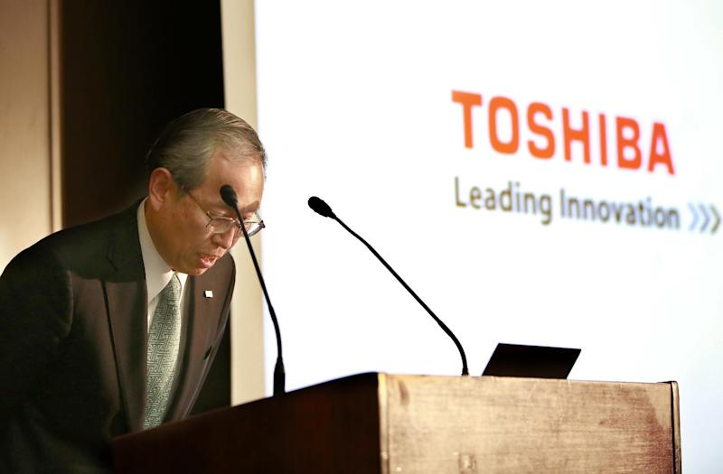"""Toshiba Corp. President Satoshi Tsunakawa bows during a press conference at the company's headquarters in Tokyo, Tuesday, Feb. 14, 2017. Japanese electronics and energy giant Toshiba said Tuesday that its chairman is resigning to take responsibility for problems that will result in a 713 billion yen ($6.3 billion) loss in its nuclear business. Toshiba warned, however, that unaudited financial results it announced may change """"by a wide margin."""" It earlier delayed reporting its official financial results by a month, citing auditing problems related to the losses in its nuclear business. That sent Toshiba stock tumbling 8 percent in Tokyo trading. (AP Photo/Shizuo Kambayashi)"""