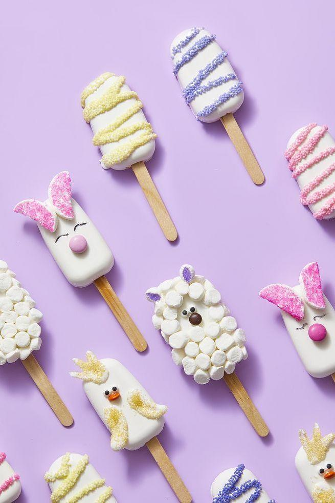 """<p>This safe-to-eat edible """"raw"""" cookie dough tastes amazing as a treat year-round, but you can make it Easter-fied with some decorating prowess. </p><p><strong><em><a href=""""https://www.womansday.com/food-recipes/a31978195/cookie-dough-pops-recipe/"""" rel=""""nofollow noopener"""" target=""""_blank"""" data-ylk=""""slk:Get the Cookie Dough Pops recipe."""" class=""""link rapid-noclick-resp"""">Get the Cookie Dough Pops recipe. </a></em></strong></p>"""