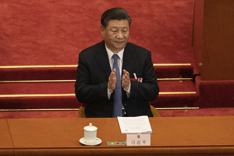 Chinese President Xi Jinping applauds during the second plenary session of China's National People's Congress (NPC) at the Great Hall of the People in Beijing, Monday, May 25, 2020. (Roman Pilipey/Pool Photo via AP)